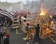 Protesters wearing red caps, the symbol of protest in the region, take part in a demonstration to maintain jobs in Quimper